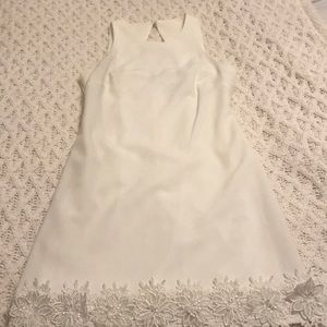 Women's white dress with flowers at the bottom